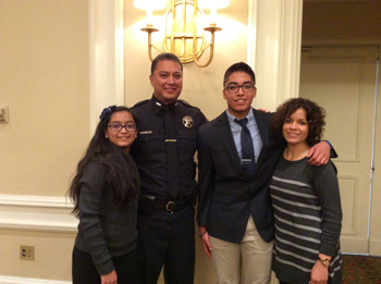 Ralph Reyna in his Denver deputy uniform and standing with his family.