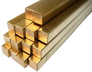 Brass square bar stock in a stack of 14 units.