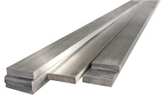Stainless steel flat bar stock in a stack.