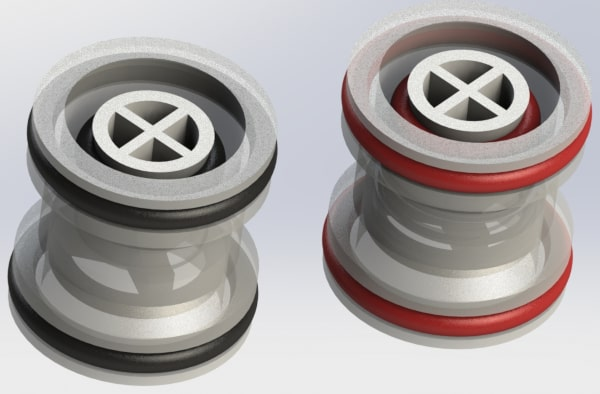 Two polypropylene modular check valve C R T G series cartridges with black (Buna N, EPDM or Viton) and red (silicone) O rings.
