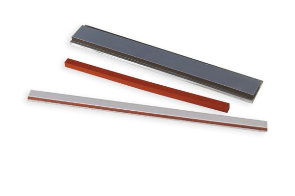 A color photo of custom heat seal sealing bars or jaws and a seal bar assembly.