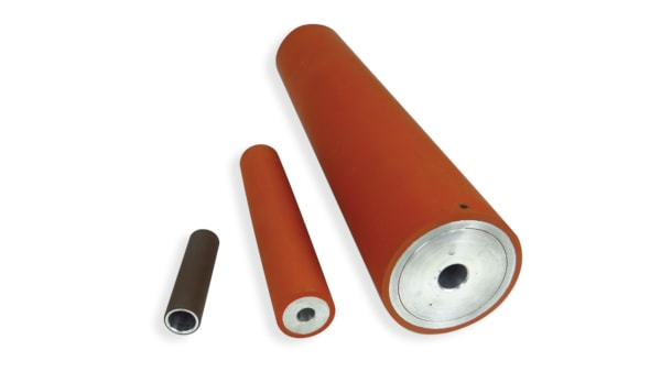 A color photo of custom rubber rollers made of high temperature silicone rubber bonded to metal cores.
