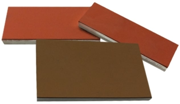 United Silicone Ultrasil (red) and Thermosil (brown) metal bonded silicone rubber sheet stock.
